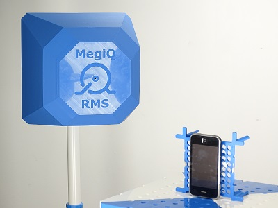 A photograph of the MegiQ Radiation Measurement System mesuring an iPhone